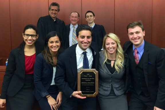 Back row: Final round judges Frank Vasquez, partner at White & Case; Michael Collins, QC; and Patrick Pearsall, attorney at State Department/Legal. Front row: Sarai Infante, Amber Unwala, Omeed Assefi, Alanna Kennedy, and Nick Gordon.