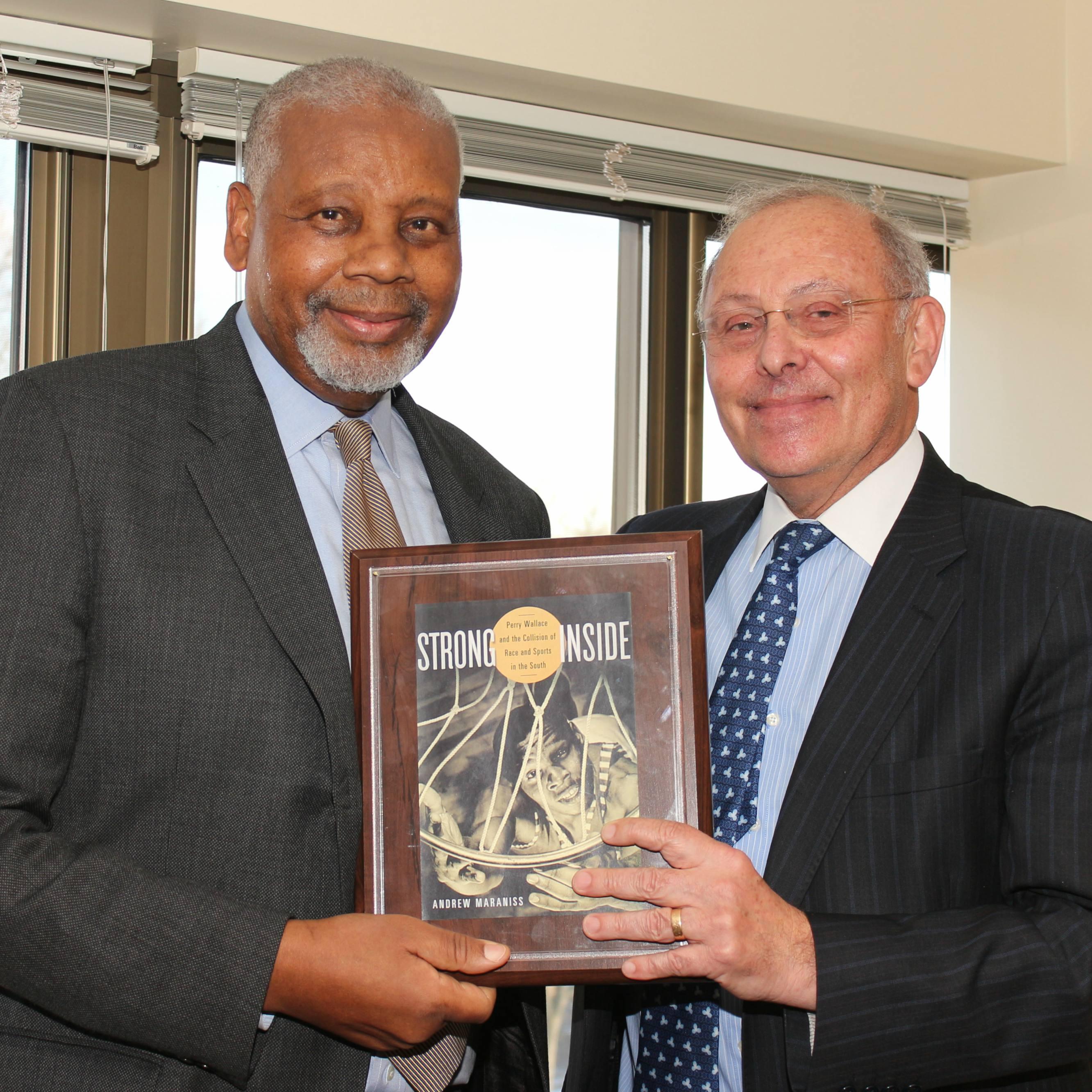 Dean Emeritus Grossman recognizes the achievements of long-serving AUWCL Professor Wallace.
