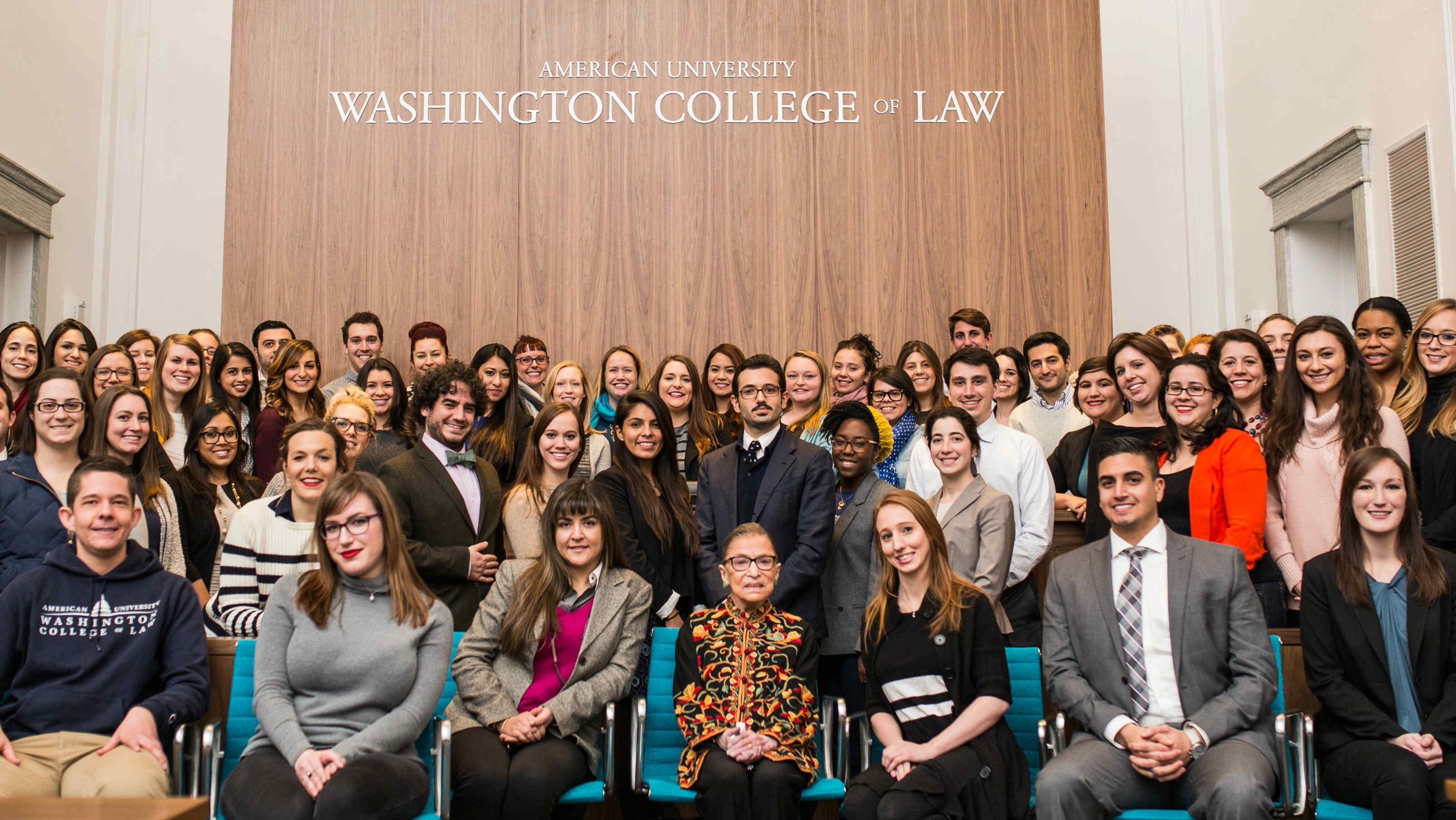 After delivering the keynote address at the February 2016 ribbon-cutting celebration for the new Washington College of Law, Justice Ginsburg took a tour of the law school and paused for a photo with students in the new Weinstein Courtroom