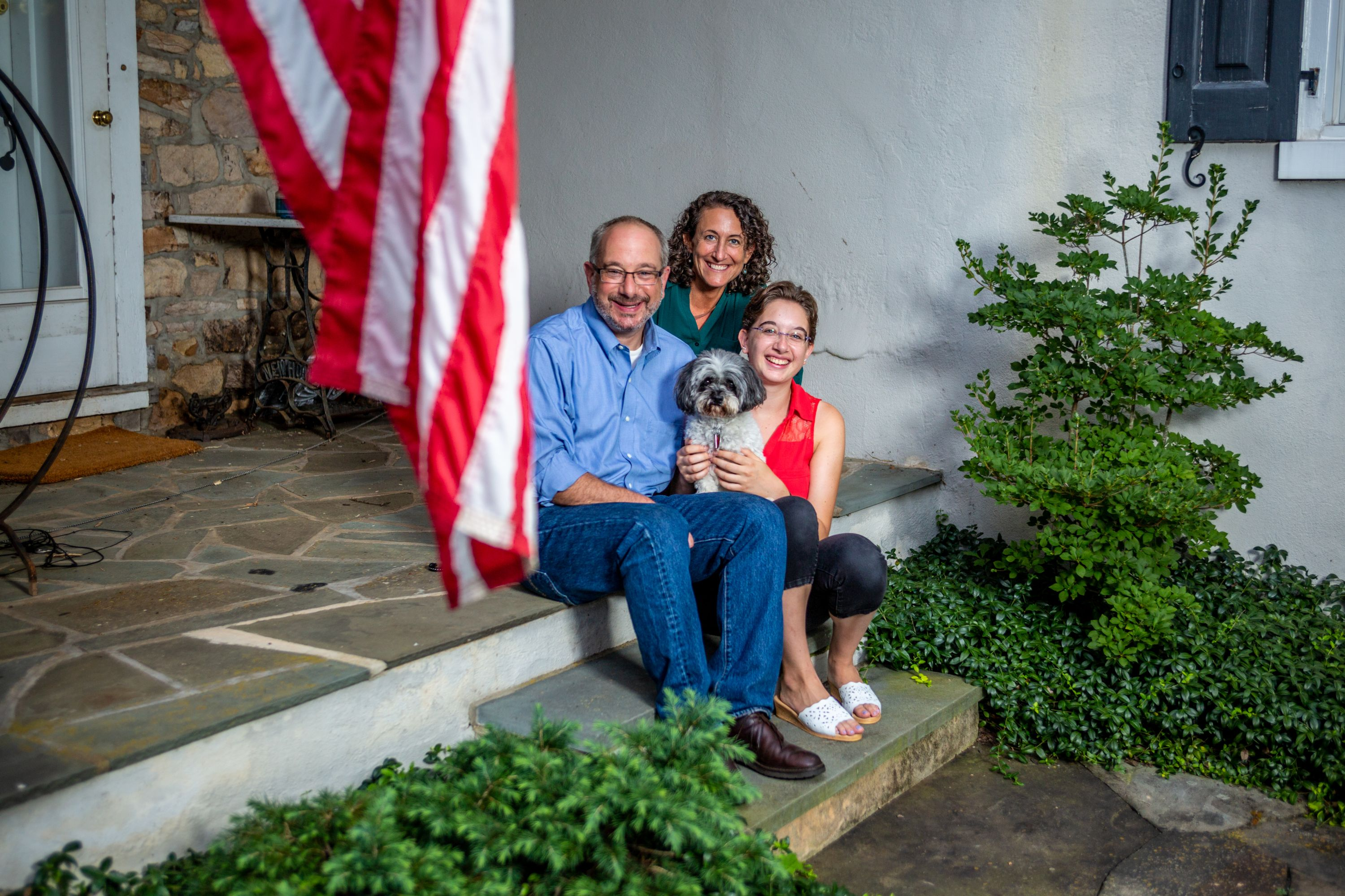Jordan Yeager '92, Kathy Boockvar '93, their daughter Colette, and dog Zoie