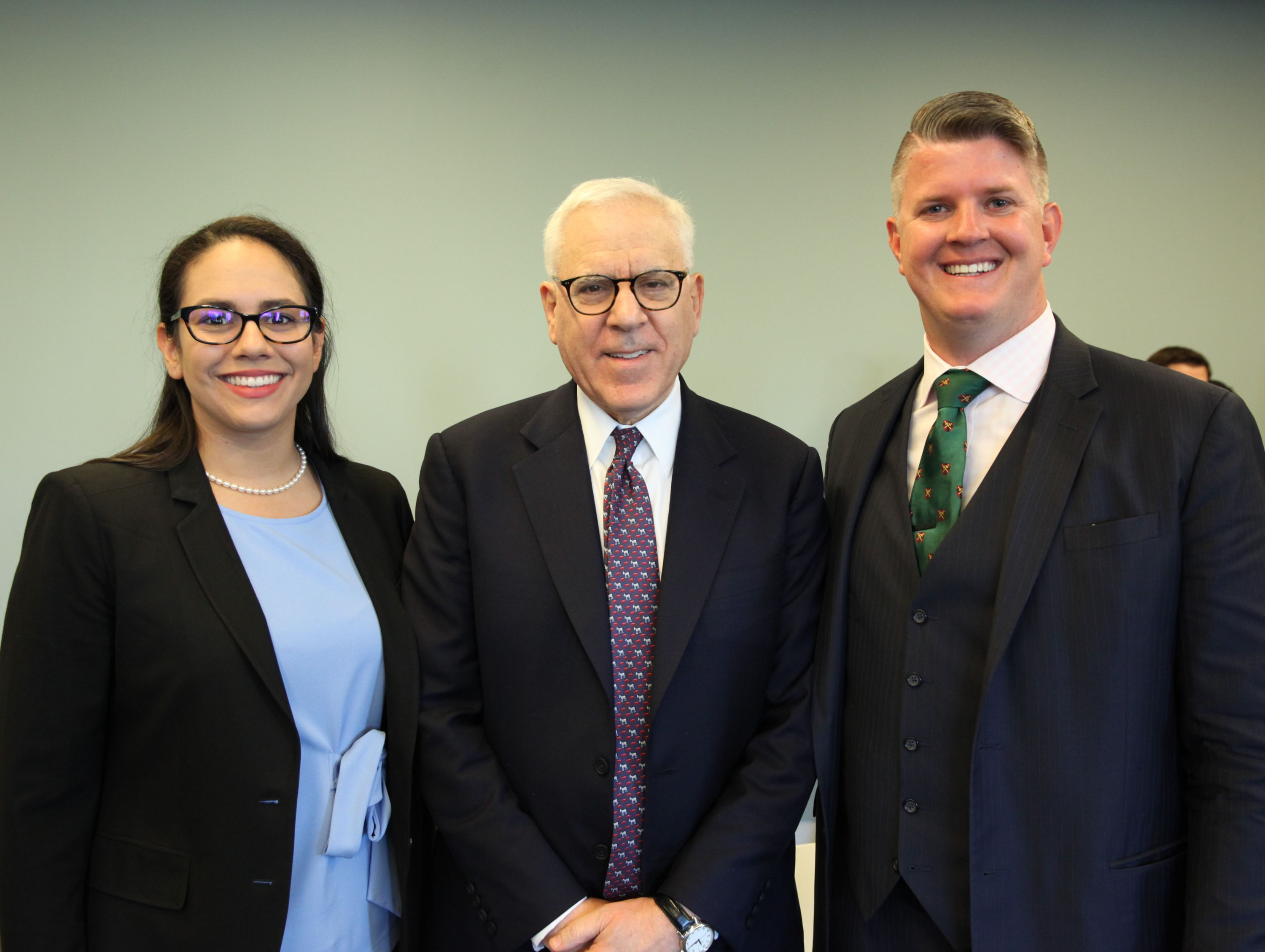 David Rubenstein (middle) with event organizers: students Christina Ravelo and Chris White.