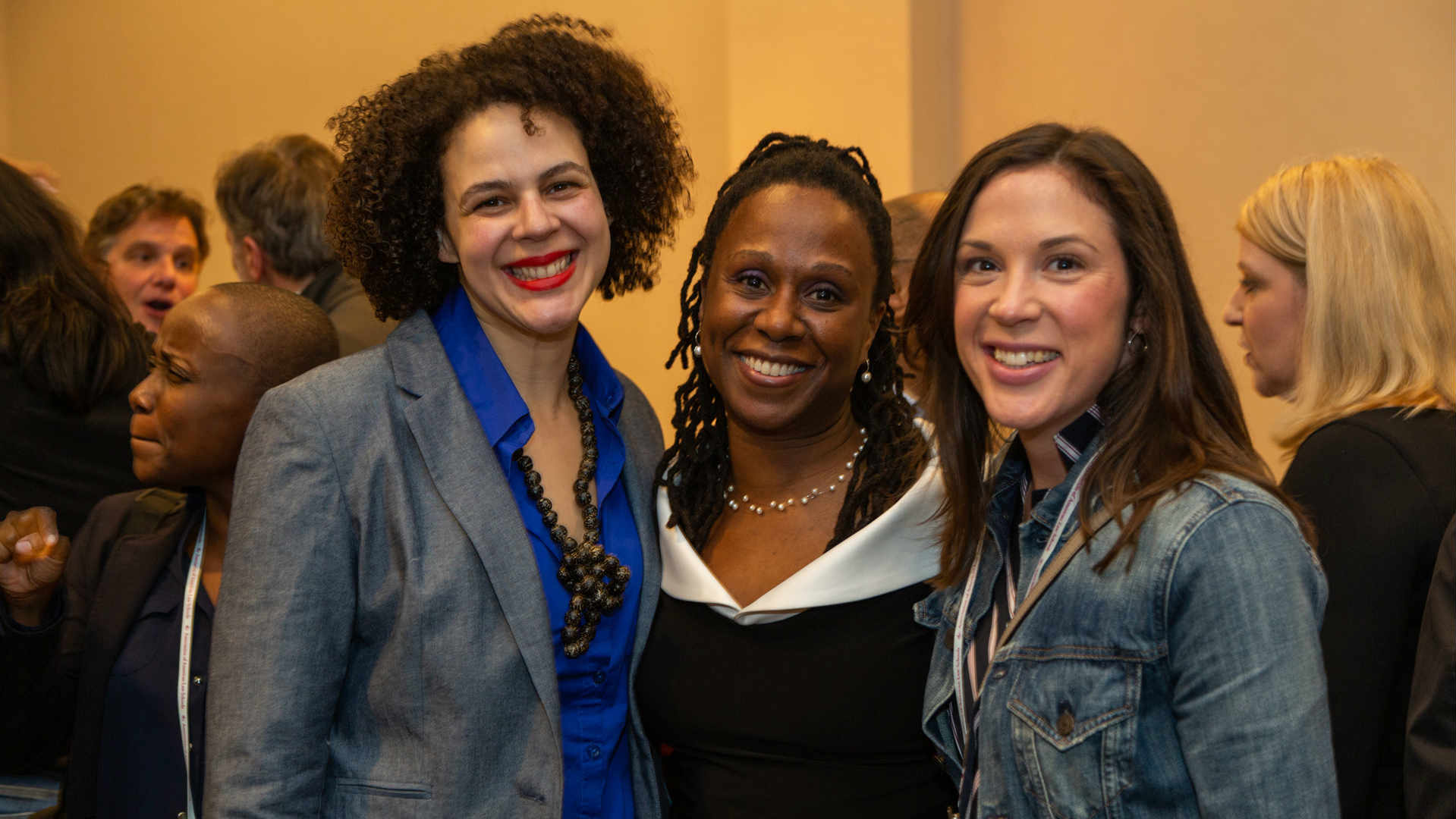 Professor Sherley Cruz, Dean Camille Nelson, and alumna at the third annual Red, White, and Brew reception.