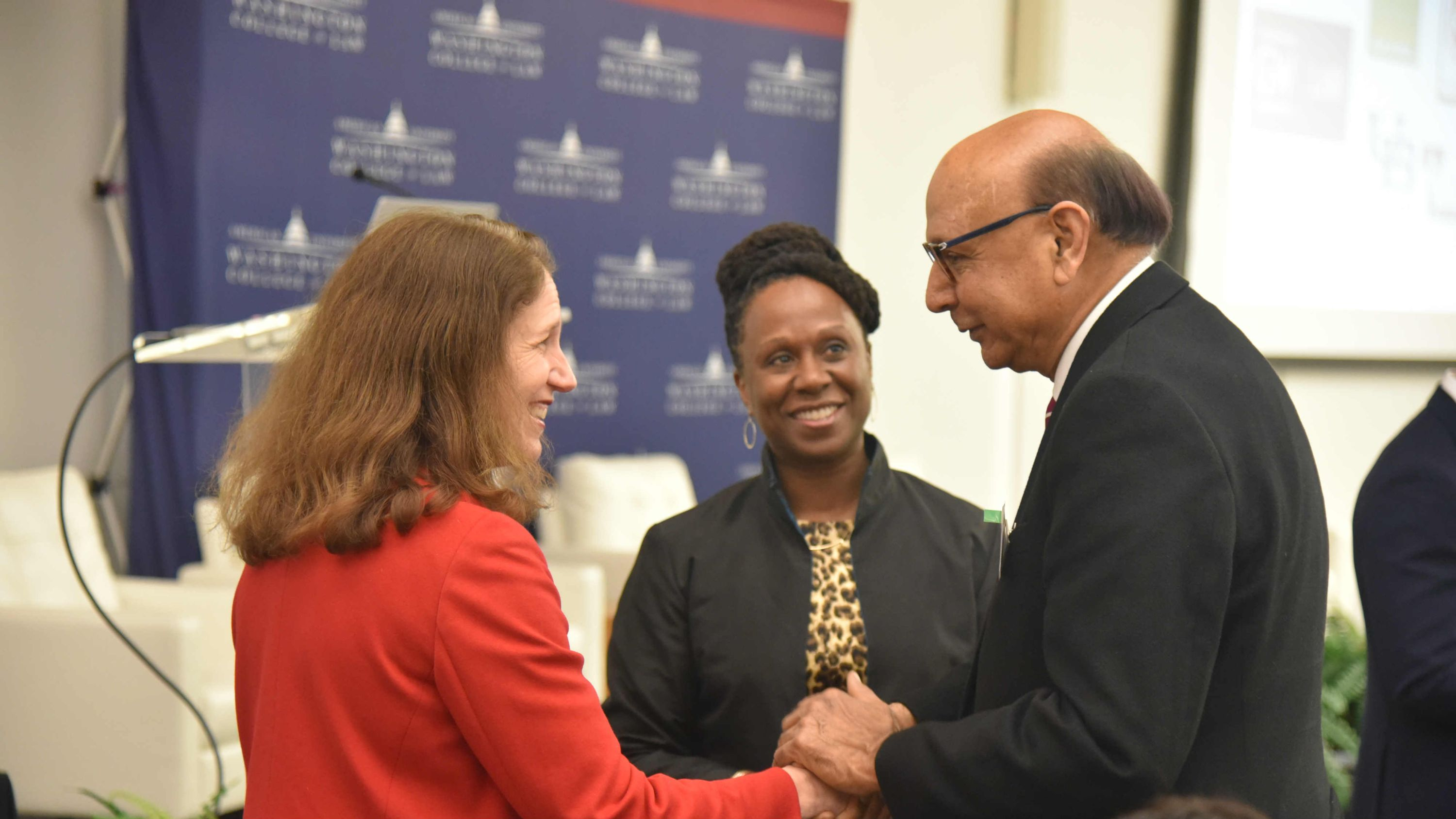 American University President Sylvia Mathews Burwell and AUWCL Dean Camille Nelson Greet lawyer and Gold Star Father Khizr Khan.