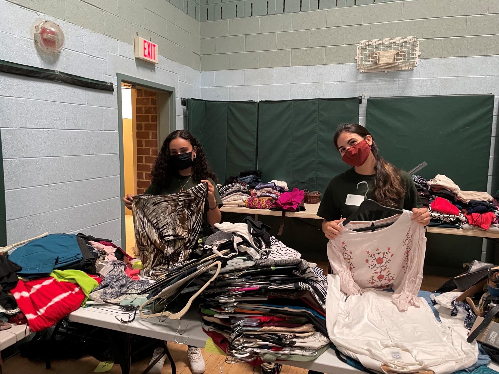 Students sort clothing at A Wider Circle.