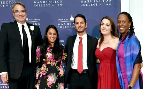 Vice Dean Tony Varona (left) with Dean Camille Nelson (right) and 2017 Myers Scholars Vidya Dindiyal, Lucas Novaes, and Victoria Latus.