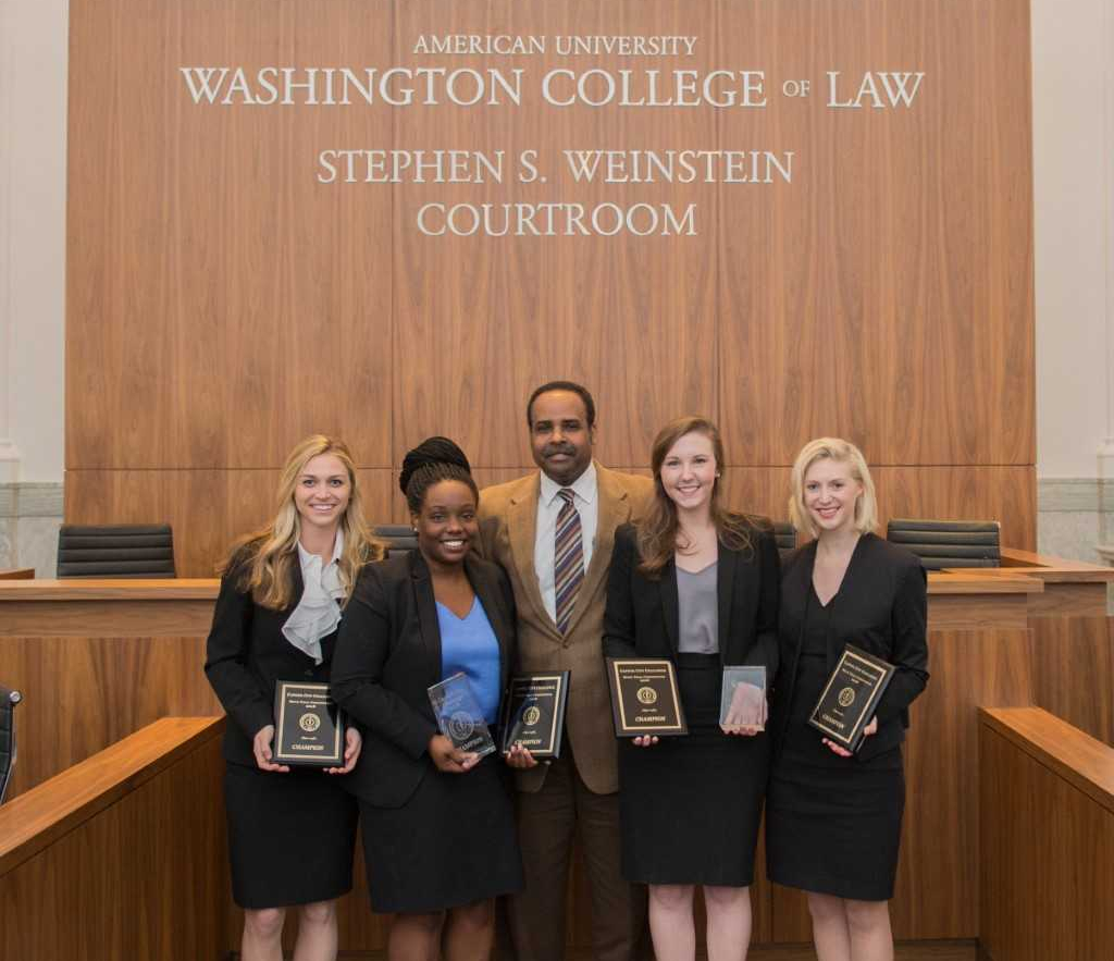 The Campbell University Adrian Wiggins School of Law,   Alex Puszczynski, Latisia Fields, Meredith Kittrell, and Dale Stephenson with 2018 Capitol City Challenge final round presiding judge, the Honorable Eric Christian.