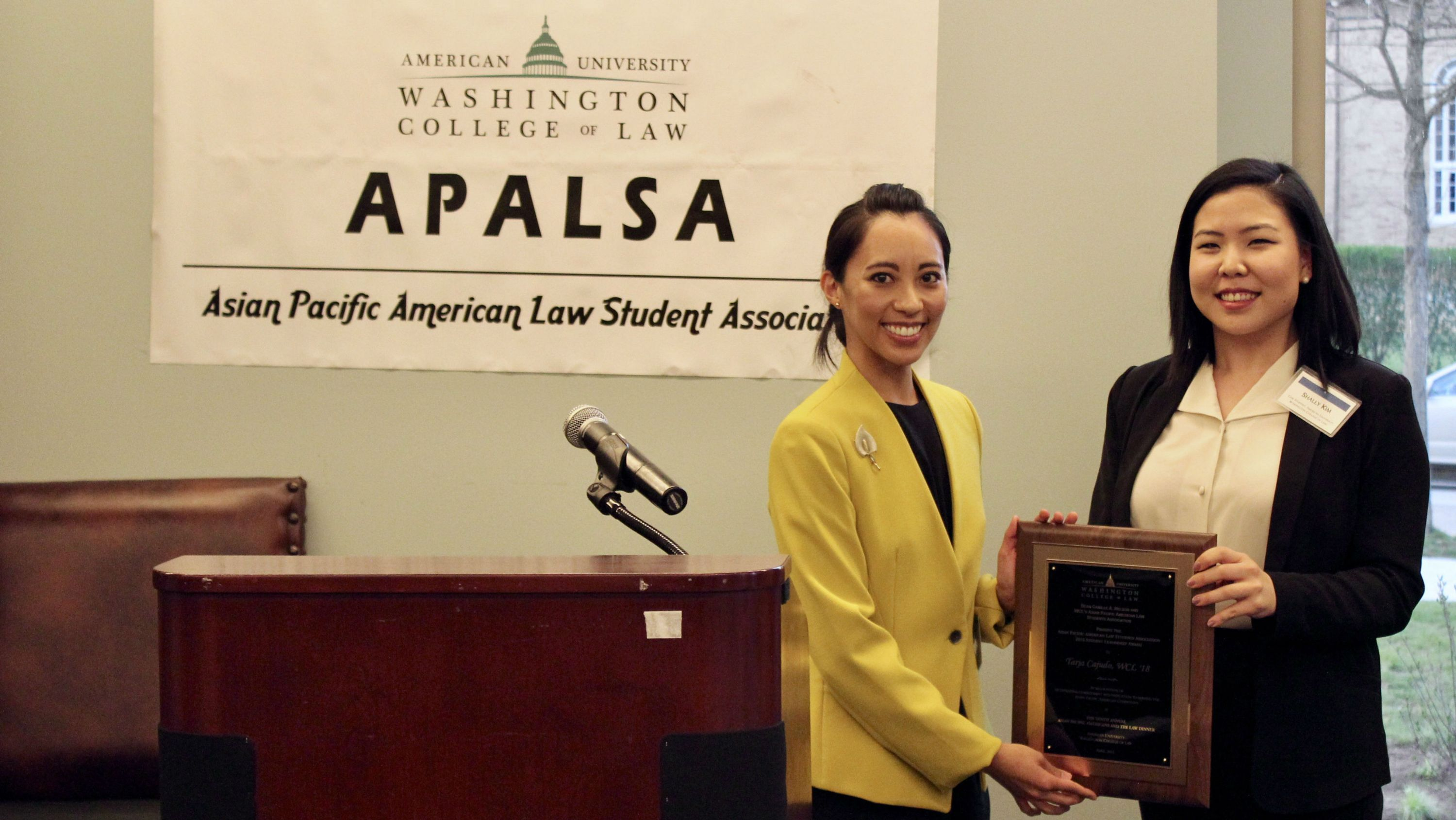 APALSA's President-Elect Shally Kim, JD Candidate '19, presenting the APALSA Student Leadership award to Tarja Cajudo, JD Candidate '18