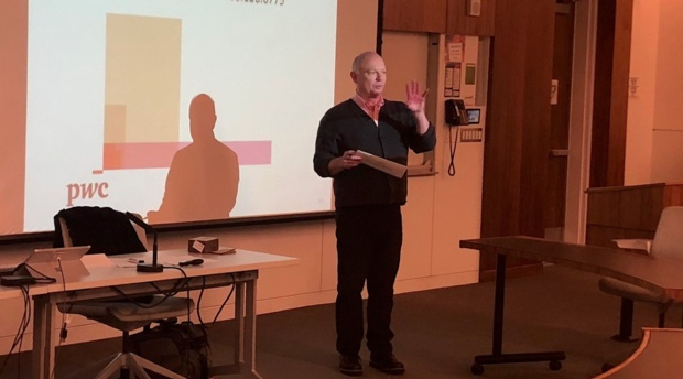 Professor Ken Anderson introduces Tim Shields '10 during the Business Basics Bootcamp.