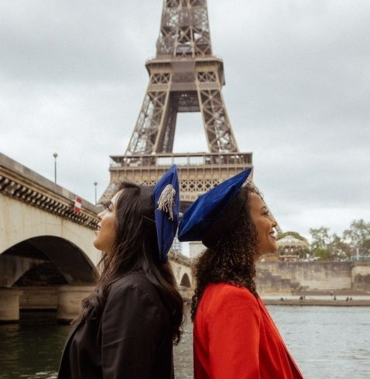 Marcela Velarde '21, left, and Lisa Ndembu Lumeya '21 celebrating graduation in Paris, France.