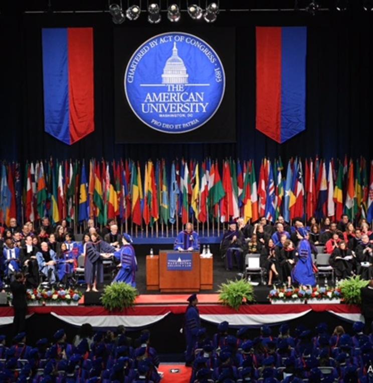 AUWCL graduates receive their diplomas.
