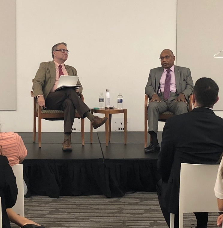 A conversation between alum Judge Reggie Walton '74, U.S. District Judge for D.C., and Vice Dean Tony Varona at orientation.