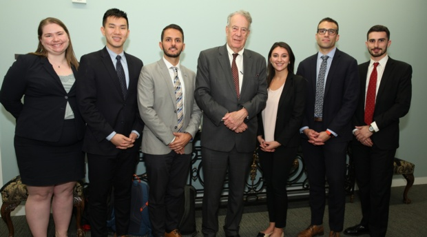 Judge Timothy Dyk, center, at a Jurist-in-Residence event with AUWCL students.