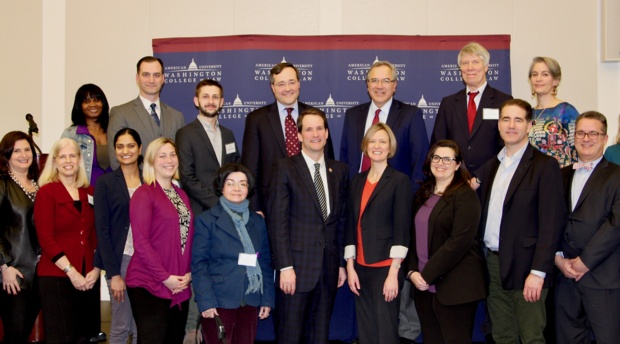 Rep. Jim Himes with faculty panelists and attendees.