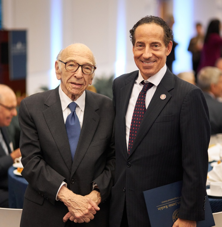 Professor Emeritus Herman Schwartz with Congressman Jamie Raskin, who presented a Congressional citation.