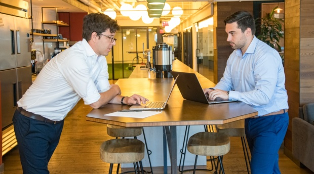 Jonathan Stroud '13, Chief IP Counsel at Unified Patents Inc., works with his extern, rising 2L Nicholas Sullivan.