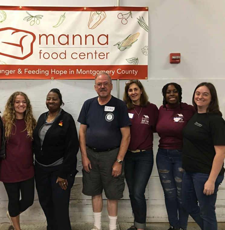 Students and staff participating in IMBY at Manna Food Center in D.C.