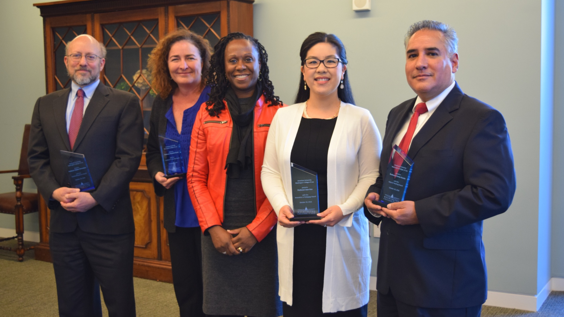 Dean Camille Nelson, center, with AUWCL Teaching and Service Award recipients, Professor Robert Dinerstein, Professor Elizabeth Earle Beske, Professor Jean Han, and Judge Carlos Acosta