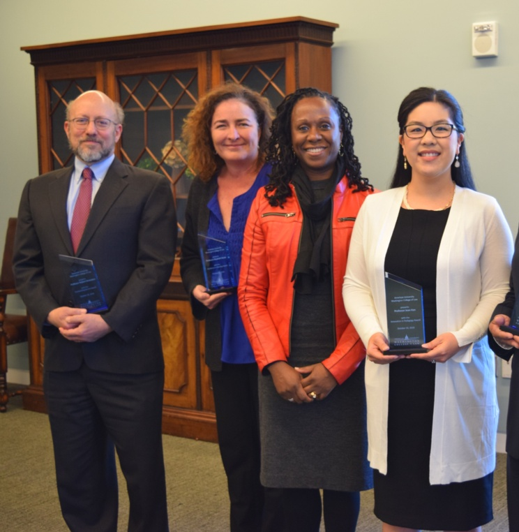 Four AUWCL Professors Recognized for Teaching, Service