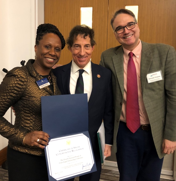 Rep. Jamie Raskin, with AUWCL Dean Camille Nelson and Professor Tony Varona, presented a Certificate of Special Congressional Recognition for the Fourth National People of Color Legal Scholarship Conference.