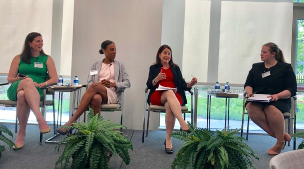 AUBLR Senior Articles Editor Amy D'Avella moderates a discussion with AUWCL Associate Professor Hilary Allen, GW Law Professor Lisa Fairfax, and former SEC Commissioner Kara Stein.